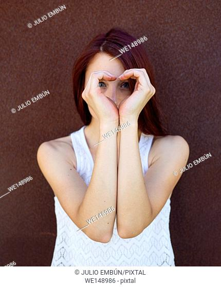 vikinga portrait of young woman hipster, leaning on a metal wall