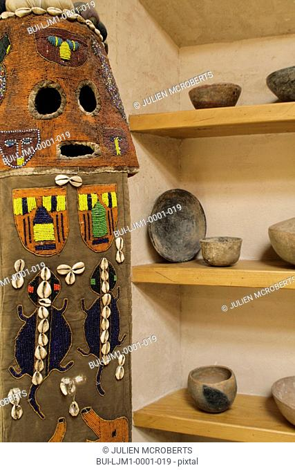 Beaded African mask and Native American pottery