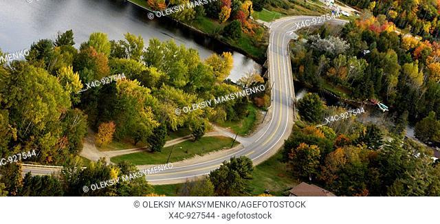 S-curve of a winding country road in fall  Muskoka region Dorset, Ontario, Canada
