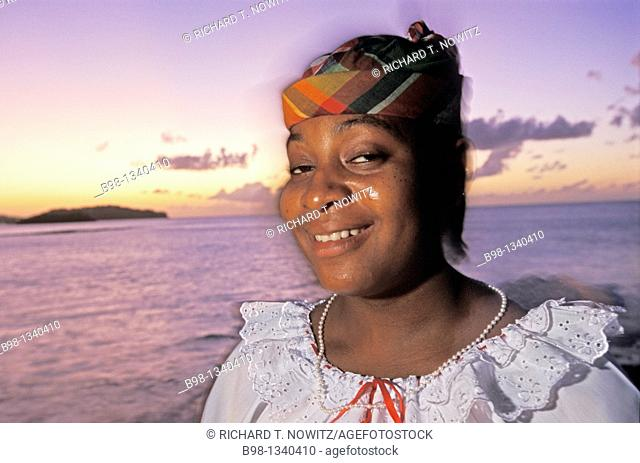 Local woman part of folk dance company at sunset Saint Lucia, West Indies