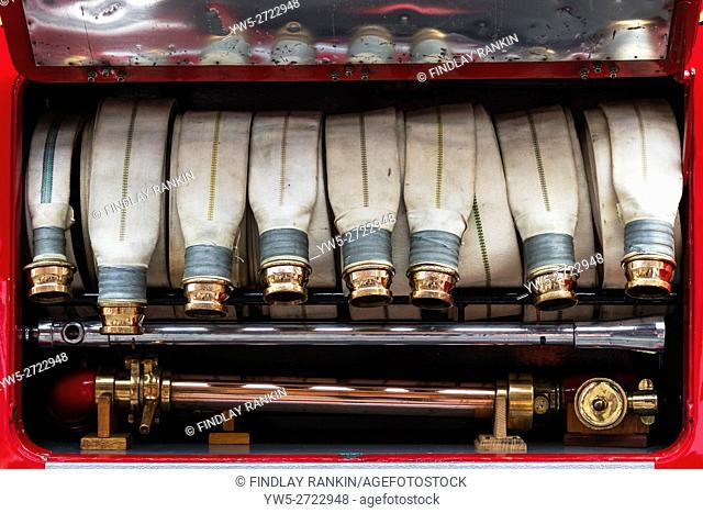 Canvas hoses and brass coupling on a 1937 vintage Fire engine