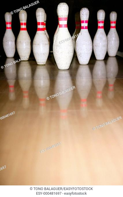 Bowling bolus row reflexion on wooden parquet floor