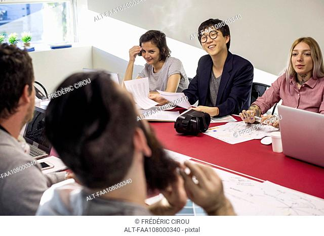 Colleagues collaborating during meeting
