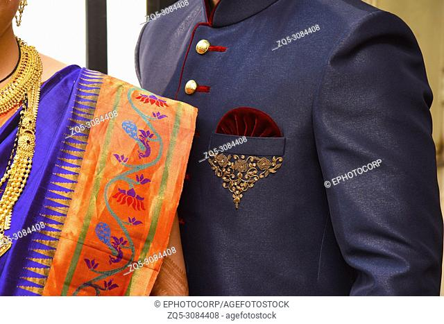Details on the Bride and Groom's costumes, wedding, Pune, Maharashtra, India