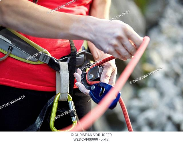 Close-up of female climber with climbing equipment
