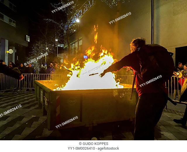 Tilburg, Netherlands. Container on Fire after disposing last torches at a torch procession for peace finish, pondering all the Christmas wishes on the Christmas...