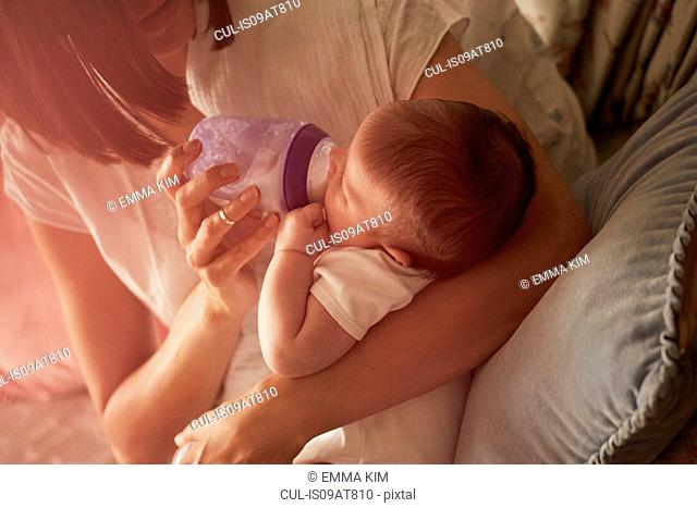 Mother feeding baby in arms