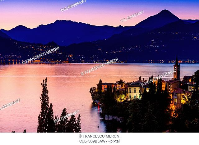 Buildings illuminated at sunset by Lake Como, Varenna, Italy