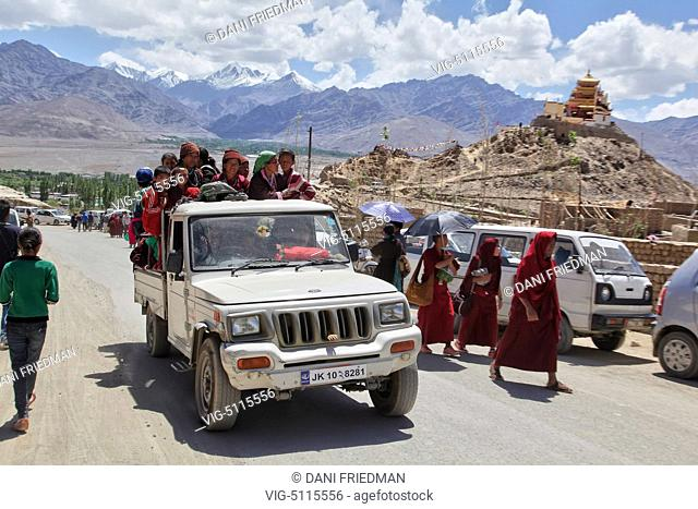 Ladakhi Buddhist pilgrims travel in an overloaded vehicle in the city of Leh after listening to His Holiness the 14th Dalai Lama perform prayers during the 33rd...