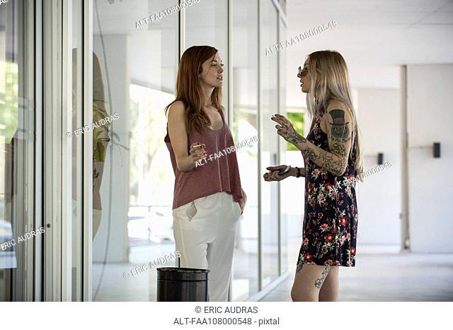 Women taking a cigarette break together