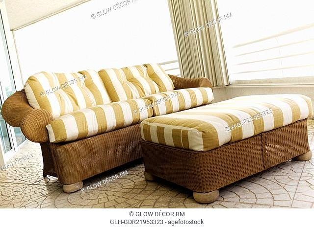 Couch with a footstool