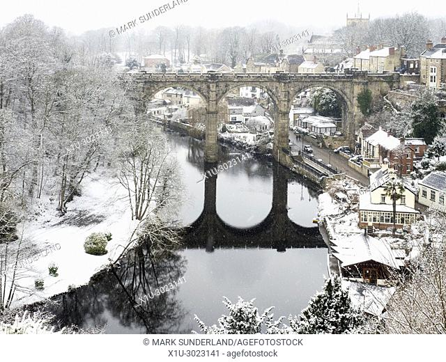 Snow falling at the Railway Viaduct over the River Nidd at Knaresborough North Yorkshire England