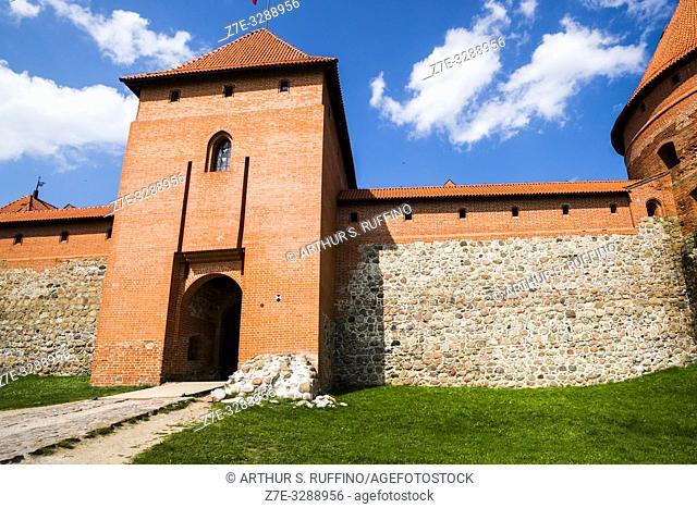 Forecastle wall, gatehouse and one of the defense towers. Trakai Island Castle, Lake Galve, Trakai, Lithuania, Baltic States, Europe
