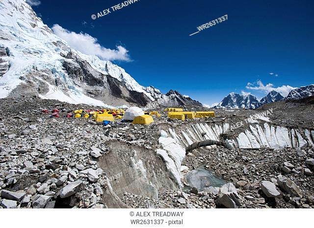 Tents at Everest Base Camp set up on the glacier among the boulders and holes in the ice, Khumbu Region, Nepal, Himalayas, Asia