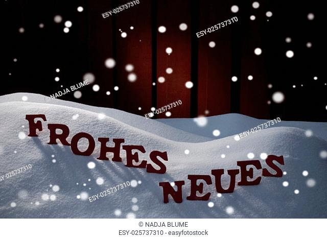 Red Letters Building German Word Frohes Neues Means Happy New Year As Decoration Card For Seasons Greetings. Snow And Snowy Scenery With Snowflakes