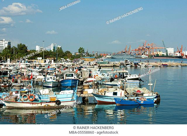 Turkey, Mersin, fishing harbour, at the background the modern industrial harbour
