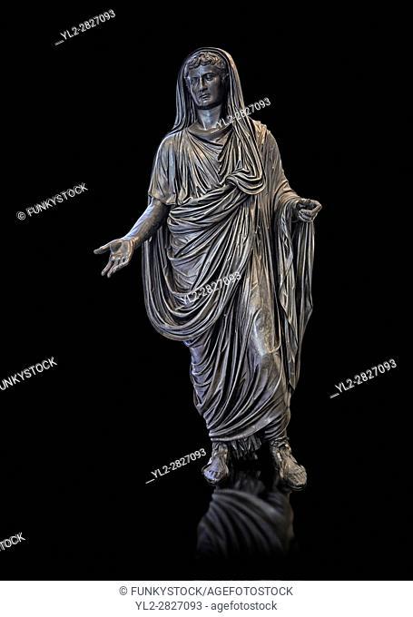 Roman bronze staue of Augustus Ceasar as Pontifex Maximus, late first century B. C, Naples National Archaeological Museum, black background