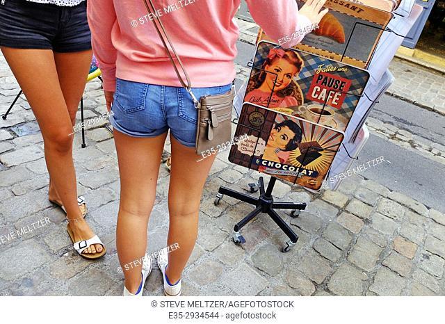 Two young women in shorts shopping, Pézenas, France