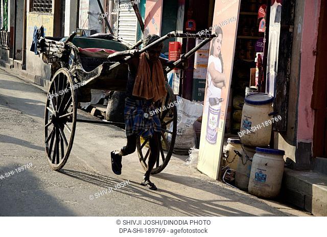 man pulling hand rickshaw Kolkata West Bengal India Asia