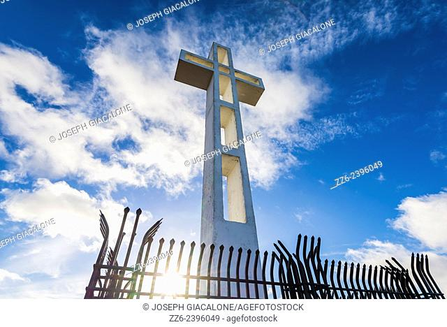 Looking up at the Mount Soledad Cross with clouds overhead. La Jolla, California, United States