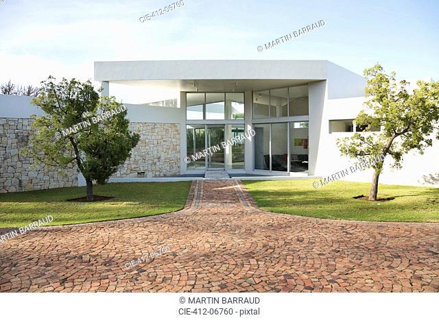 Stone walkway to modern house