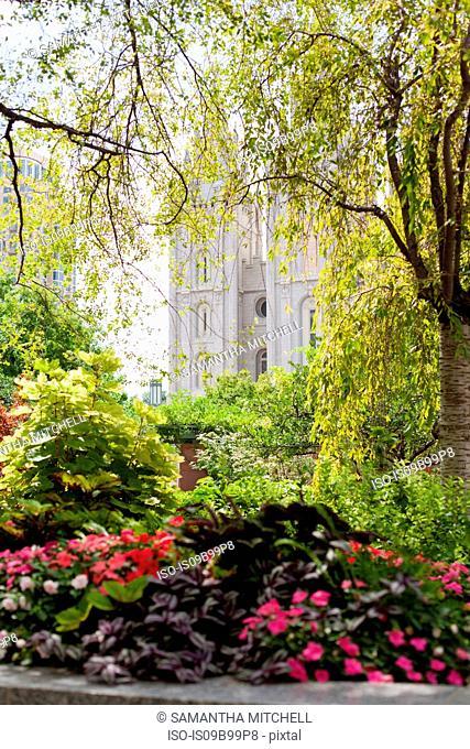 Park gardens and Mormon temple spires, Salt Lake City, Utah, USA