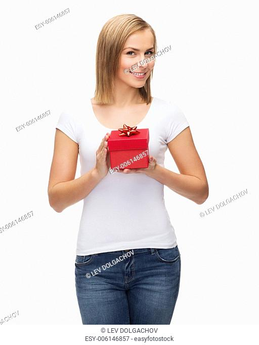 holidays, love and happiness concept - beautiful girl with gift box