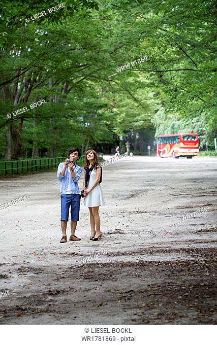 A couple, a man and woman in a Kyoto park