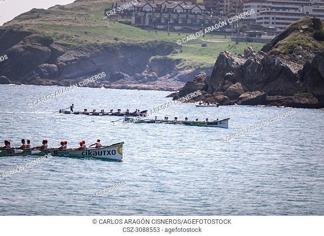 CASTRO URDIALES, SPAIN - JULY 15, 2018: Competition of boats, regata of trainera, Ondarroa Cikautxo, Cabo, Donostiarra and Santurtzi Iberdrola boats in action...