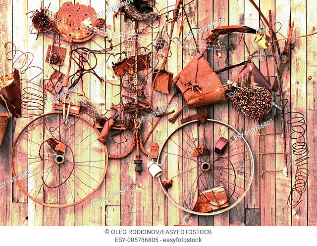 Still-life of rusty metal items on wooden background