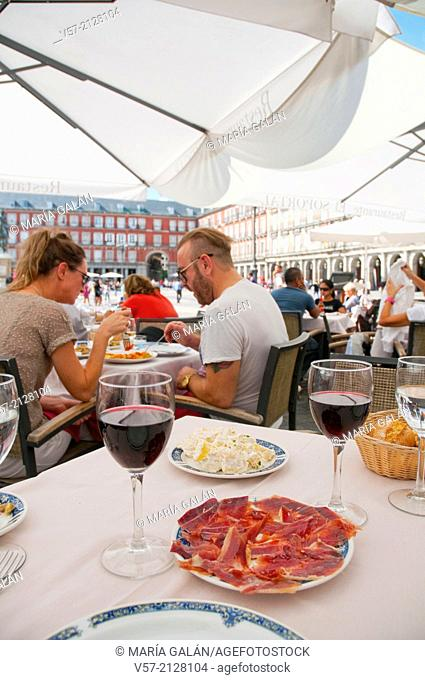 Ration of Iberian ham in a terrace at the Main Square. Madrid, Spain