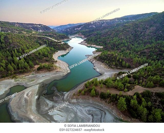 Aerial view of Diarizos river at sunset in Paphos, Cyprus. The river cutting through the green valley and lush forest of laona mountain leading to the Venetian...