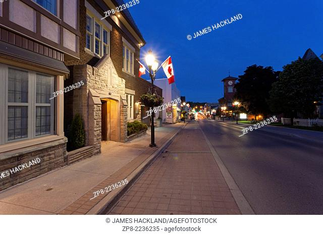 Downtown 'Main Street' Newmarket at dusk Roadhouse and Rose Funeral Home in the foreground. Ontario, Canada