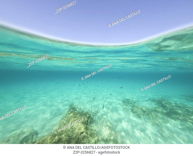 Underwater the turquoise water in El Calo de San Agusti Formentera island Balearics Spain