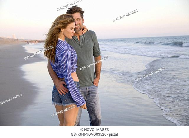 Three-Quarter Length Portrait of Mid-Adult Couple Standing at Beach