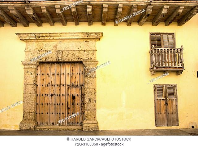 Colonial door to house in the ancient walled city of Cartagena of indies. Historical patrimony of the humanity for the UNESCO. Cartagena, Colombia