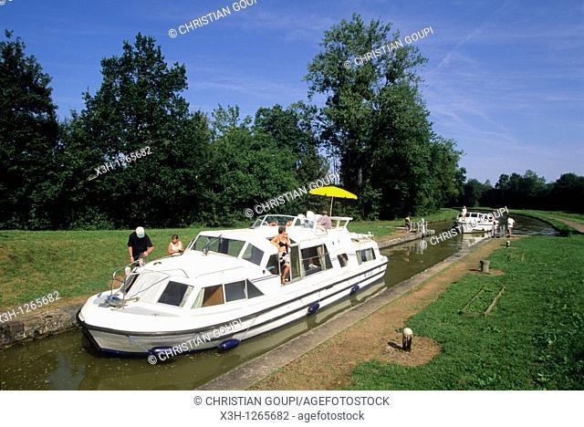 river tourisme on the Canal du Nivernais, Nievre department, region of Burgundy, center of France, Europe
