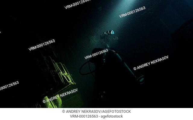 Diver inspects the engine room of the wreck Giannis D, Red Sea, Sharm el Sheikh, Egypt, Sinai