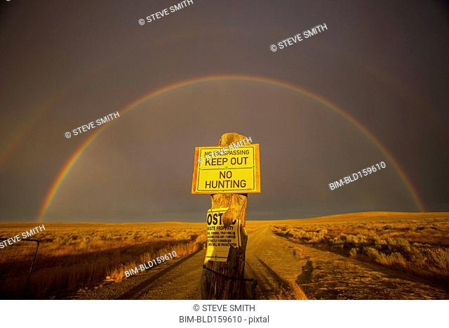 Warning sign in private fields under rainbow