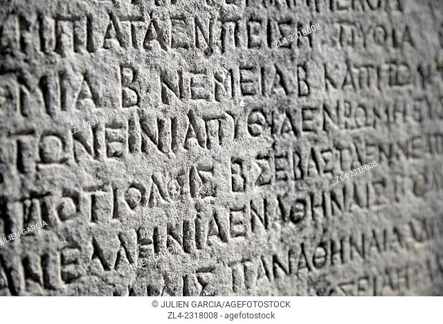 Ancient greek inscription carved in stone. Greece, Central Greece, Sterea Ellada, Phocis, Ancient Delphi, listed as World Heritage by UNESCO