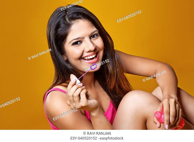 Young woman blowing soap bubbles