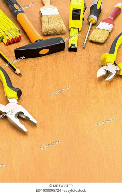 Set of work tools on wood panel background with copy space