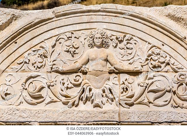 Marble reliefs in Ephesus historical ancient city, in Selcuk,Izmir,Turkey. Figure of Medusa with ornaments of Acanthus leaves,Detail of the Temple of Hadrian