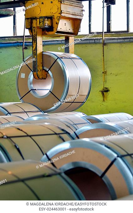 Steel coil in warehouse and crane