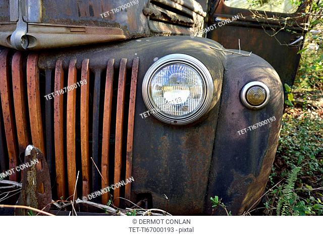 Front of rusty abandoned car