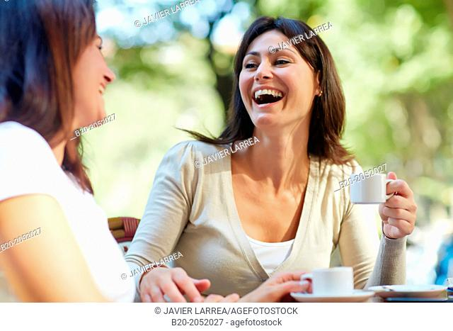 Women sisters 35 and 40 years taking coffee on a terrace. Donostia. San Sebastian. Gipuzkoa. Basque Country- Spain