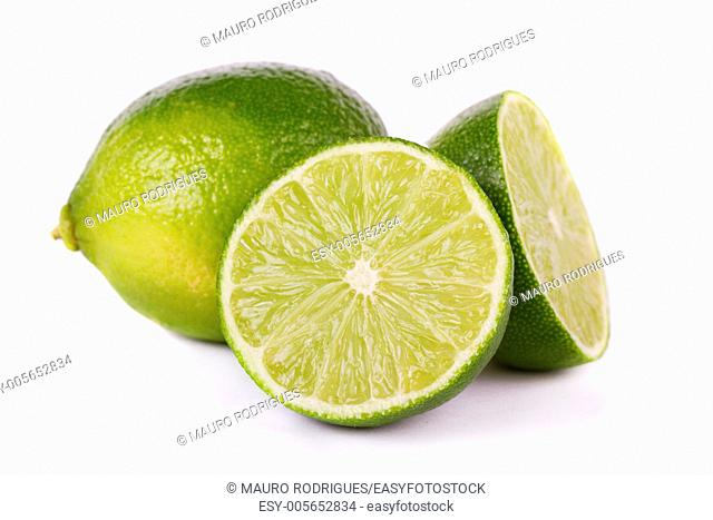 Close up view of a group of limes isolated on a white background