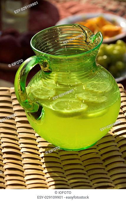Pitcher of lemonade with sliced lemons