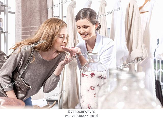 Client smelling at beauty product in wellness shop