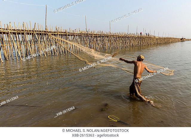 Man casting net on the Tonle Sap River near Phnom Penh, Cambodia